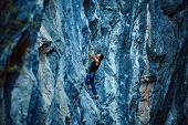 pic of climbing wall  - rock climber climbs on a rocky wall - JPG