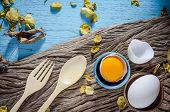 image of duck egg blue  - Still life broken white eggs and egg yolk on a wooden rustic background - JPG