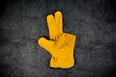 picture of engineering construction  - Yellow Leather Construction Engineer or Builder Working Protective Gloves Making Three Fingers Gesture - JPG