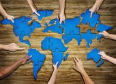 foto of jigsaw  - Group of Hands Holding Jigsaw Puzzle Forming World - JPG
