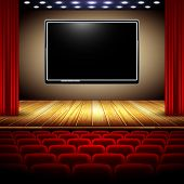 pic of soffit  - auditorium cinema system with screen stage and red curtain - JPG