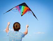 pic of kites  - joy teen flies kite into blue sky outdoor summer - JPG