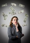 picture of lottery winners  - Girl in grey and falling dollar banknotes - JPG