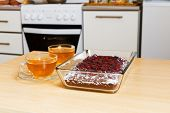 picture of cherry pie  - Two cup of tea and chokolate pie with cherry on the domestic kitchen - JPG