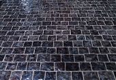 Постер, плакат: Cobblestone Pavement On Square Background Texture