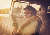 foto of hippy  - Young black hippie woman in a retro van  - JPG
