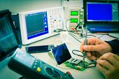 stock photo of microprocessor  - adjustment the microprocessor in a workshop - JPG