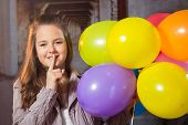 image of ten years old  - Ten year old caucasian girl with long hair posing in the studio with balloons - JPG