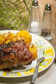 stock photo of duck breast  - Roast duck breast with potatoes on the plate - JPG