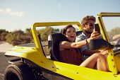 image of excite  - Excited happy couple enjoying road trip in their car - JPG