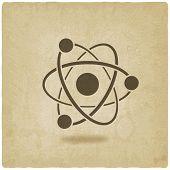 stock photo of proton  - molecule atom symbol old background  - JPG