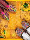 stock photo of flea  - Colorful ethnic shoes on yellow Rajasthan cushion cover on flea market in India - JPG
