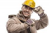 picture of hard-on  - Young dirty Worker Man With Hard Hat helmet  holding a hammer and smiling isolated on White Background - JPG