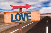 Постер, плакат: Love sign with road background