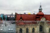 picture of partition  - The roofs of the city from the top of the glass partition with raindrops and the horizon - JPG