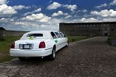 picture of limousine  - White wedding limousine in the yard of fortress Narva Estonia  - JPG