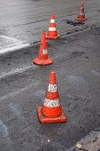 foto of cone  - Orange safety cones are on the new asphalt - JPG