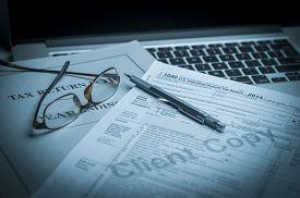 foto of calculator  - Tax accounting 1040 US Tax Form - JPG
