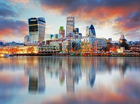 image of reflections  - London skyline at a sunset with reflection in Thames river - JPG