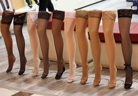 stock photo of stocking-foot  - Beauty and fashion stockings on a dummy in shop - JPG