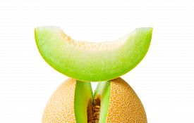 stock photo of honeydew melon  - Ripe fresh melon honeydew and a slice over it closeup isolated on white background - JPG