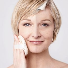 pic of face-powder  - Close up of woman applying cosmetic powder on face - JPG