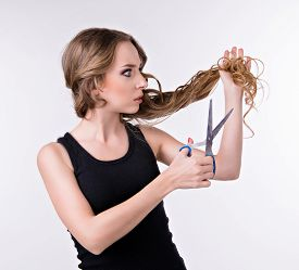 pic of split ends  - Girl Cuts  Her Split Ends Of Hair - JPG