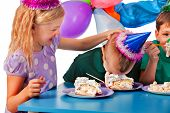 Birthday children celebrate party and eating cake on plate together . Portrait of three fun kids hap poster