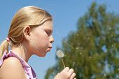 Teenager Girl Puffing To Dandelion