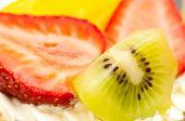 Strawberries Kiwi And Slice Of Peach On Cream