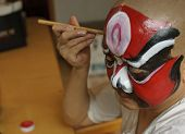 Chinese Opera Actor Is Painting His Face