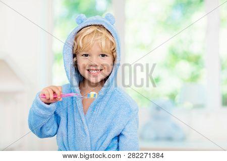 poster of Child Brushing Teeth. Kids Tooth Brush.