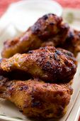 stock photo of chicken wings  - A shot of chicken wings on a plate - JPG