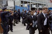 NEW YORK - MAY 2: Commuters walk past Port Authority Police Officers as they exit the World Trade Ce