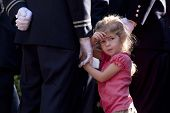 NEW YORK - SEPT 11: An unidentified child stands next to a Firefighter during ceremony at the Firefi
