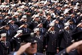 NEW YORK - SEPT 11: Firefighters salute during a ceremony at the Firefighters Memorial on September