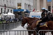 NEW YORK - NOV 17: Police officers on horseback temporarily at Broad Street and Exchange Place near
