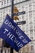 NEW YORK - NOV 17: A close up of a banner that reads 'Don't Give Up The Ship' on Broadway and Wall S