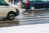 Crosswalk. Slippery Wet Asphalt City Road In Winter. Driving Cars Are Blurred In Motion. Waiting For poster