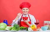 Healthy Raw Food. Dieting Concept. Eat Healthy. Girl Wear Hat And Apron Try Meal Taste. Healthy Rati poster