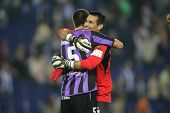 BARCELONA, SPAIN - NOVEMBER 1: Justo Villar and Medunjanin of Valladolid celebrate the victory of th
