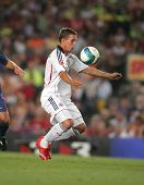 BARCELONA - AUG 22: Footballer Lukas Podolski during a friendly match between Bayern Munich and FC B
