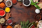 Set of various spices and herbs on wooden background. Top view with space for your recipe. Flat lay poster