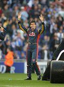 BARCELONA-APRIL 11: Formula1 driver Jaime Alguersuari waves to supporters before a Spanish League match between Espanyol vs Atletico Madrid at the Estadi Cornella on April 11, 2010 in Barcelona, Spain