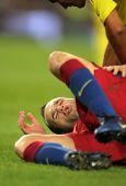 BARCELONA - NOV 13: Iniesta of FC Barcelona injured during spanish league match between FC Barcelona and Villarreal CF at Nou Camp Stadium on November 13, 2010 in Barcelona, Spain