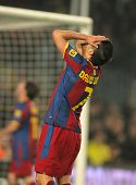 BARCELONA - JAN 12: David Villa of Barcelona in action during the match between FC Barcelona and Real Betis at the Nou Camp Stadium on January 12, 2011 in Barcelona, Spain