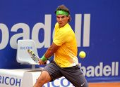 BARCELONA - APRIL 20: Spanish tennis player Rafael Nadal in action during his match against Gimeno-Traver of  Barcelona tennis tournament Conde de Godo on April 20, 2011 in Barcelona, Spain.