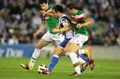 BARCELONA -MAY 2: Verdu(C) of Espanyol fight with Ekiza(R) and Javi Martinez(L) of Bilbao during a m