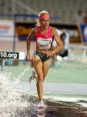 BARCELONA JULY 25: Spanish athlete Marta Dominguez runs to win her women's 3000 meter steeplechase a