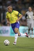 BARCELONA, SPAIN - MAY. 25: Brazilian player Roberto Carlos in action during the friendly match between Catalonia vs Brazil at Nou Camp Stadium in Barcelona, Spain. May 25, 2004.